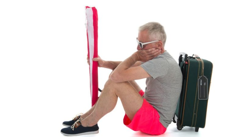 30972071 – man as traveler with suitcase having delay